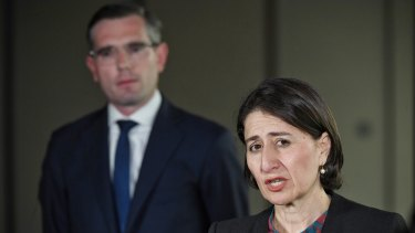 Gladys Berejiklian and Dominic Perrottet announcing a one year freeze on public service pay rises on Wednesday.