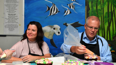 Jenny and Scott Morrison decorating cakes on the election trail.