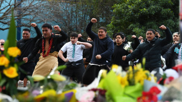 Students from Victoria University Secondary College perform a traditional dance at the service.