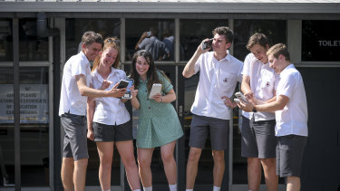 VCE students at Ringwood Secondary College joking after the stress of their maths exam.