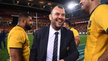 Sight to behold: Michael Cheika enjoys a laugh after an intense period of pressure on the coach.