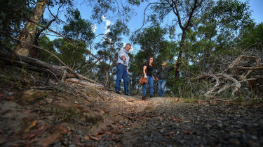 Andrew Kelly, Anna Ridgway and Lawrence Pope are  concerned about the environmental damage mountain bike riding is doing at the Yarra Bend Park.