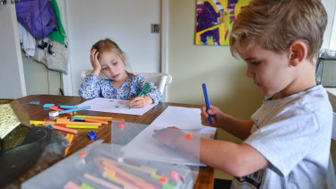 WillowFedke(3) and Leo Fedke (6)are writing letters to their elderly neighbours.
