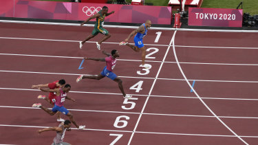 Lamont Marcell Jacobs finishes first in the men's 100m final.