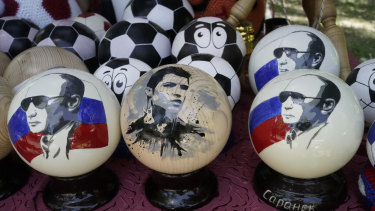 Hand made wooden balls depicting Russian President Vladimir Putin and soccer star Cristiano Ronaldo are for sale as souvenirs in Saransk, Russia.