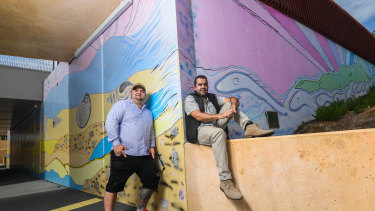 Indigenous artists Eamon Roberts, a Kamilaroi man (left) and Adam Magennis, a Bunurong man (right) painted murals at the Eel Race Road underpass, as part of a push to incorporate more Indigenous culture and art into the level crossing removal program.