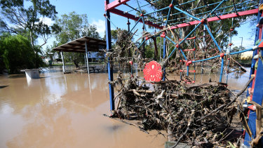 Playground equipment covered in debris  as floodwaters recede in Dalby.