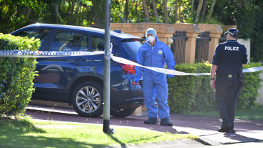 Scientific officers swarmed Dr Zeng's home on Tuesday morning.