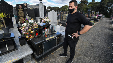 Spiros Dimitriou at his father John's grave, at the Northern Memorial Park in Glenroy. John died after acquiring a coronavirus infection at St Basil's after living there for almost three years.