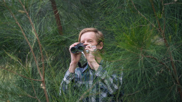 Michael Livingston searches for birds in Royal Park during lockdown.