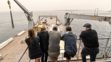 Evacuees from Mallacoota aboard the HMAS Choules.