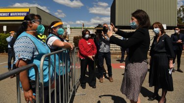 Premier Gladys Berejiklian thanks healthcare workers at the vaccination hub on Friday.