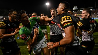 Tempers flare between Joe Tapine (left) and Stephen Crichton after a try by the Panthers.