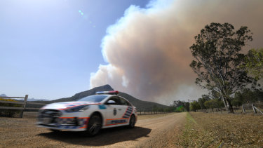 Smoke from an out-of-control bushfire billows near Clumber, south of Boonah in the Scenic Rim region, on Friday.