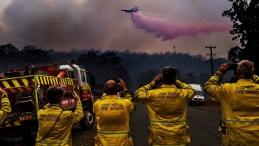 NSW's custom large aerial tanker 737 jet dumps fire retardant on a bushfire south of Port Macquarie in October last year.