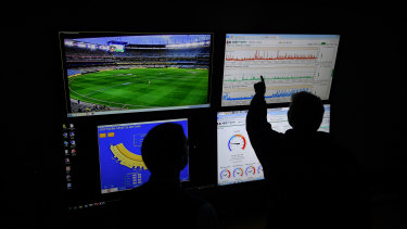 Staff in the MCG control room monitor energy use at the ground during the finals series.