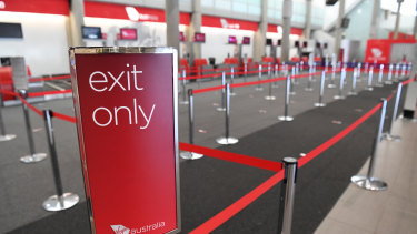 An empty Virgin Australia check-in area at Brisbane domestic airport.