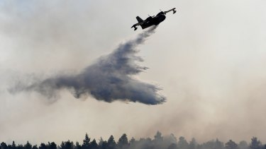 Water is dropped on a wildfire near Halkida town on Evia on Wednesday.