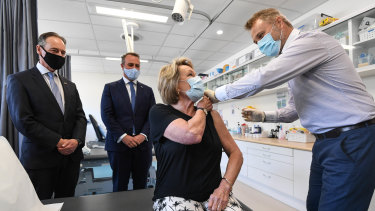Health Minister Greg Hunt, Tim Wilson MP, Dale Austin (patient) and Dr Nick Kokotis. Health Minister Greg Hunt in Sandringham visiting the Bluff Road Medical Centre. 29th March 2021 The Age News Picture by JOE ARMAO