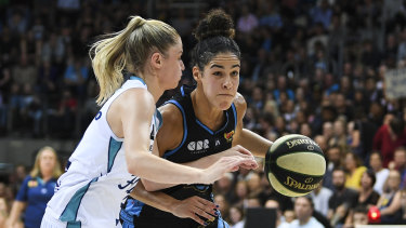 Canberra Capitals' Kia Nurse fights for the ball with Aimie Clydesdale of the Southside Flyers.