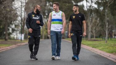 The AFL Peace Team, from left, Richmond's Bachar Houli , Toby Lipton and Saad Elhawli.