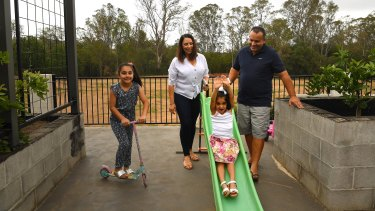 Charlize, pictured on the slide, has had two liver transplants due to a rare metabolic condition.