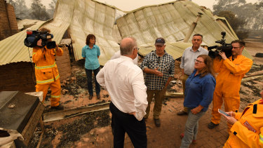 Prime Minister Scott Morrison tours a farm in fire-ravaged Sarsfield, Victoria.