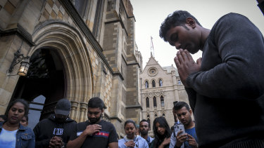 Members of Melbourne's Sri Lankan community outside St Paul's Cathedral.