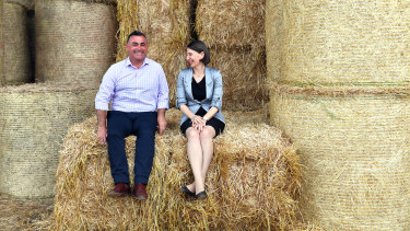 Premier Gladys Berejiklian and Deputy Premier John Barilaro on Boyd Baling farm in Lismore.