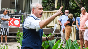 Auctioneer Tom Panos at a three-bedroom property in Lane Cove that on Saturday sold for $500,000 above the reserve.