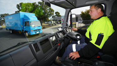 SEA Electric test driver Graeme Cook at a Dandenong South factory where the company makes electric trucks and buses.