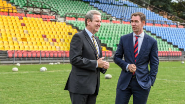 Field of dreams: Tigers president Barry O'Farrell with federal Labor candidate Sam Crosby at Concord Oval.