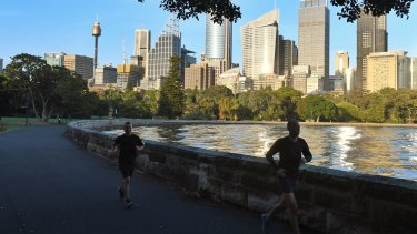 Joggers at the Royal Botanic Gardens in Sydney.