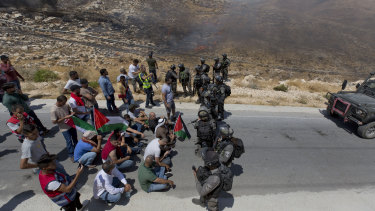 Israeli border police block the road and disperse Palestinian, Israeli and foreign activists during a rally on Friday against a newly established settlement near the West Bank village of Kufr Malik, east of Ramallah.