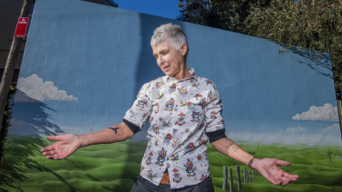 Andrea Phelan, 61, shows off her two tattoos. Getting a tattoo in your 60s and 70s is becoming more common, tattoo artists say.