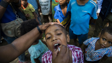 Polio vaccinations are conducted at the 8 Mile Settlement in Port Moresby.