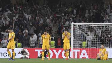 Picture of devastation: Socceroos players confront the grim reality of their 1-0 defeat to the UAE.