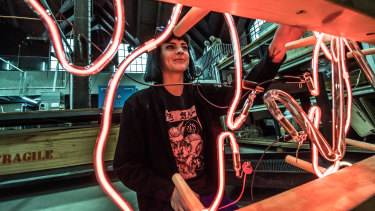Emma-Kate Hart, who is the Winter Glass artist-in-residence, working on her piece, a neon sculpture entitled Electric Bell Jar.