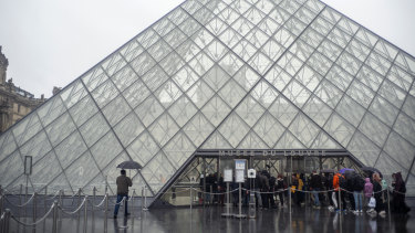 Tourists arrive at the Louvre in Paris to find it closed due to the coronavirus outbreak.