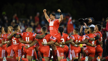 King of Tonga: Jason Taumalolo leads the Sipi Tau against New Zealand at last year's World Cup.