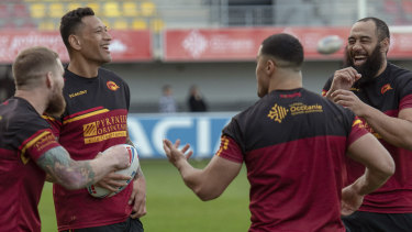 Folau shares a joke with his new teammates.