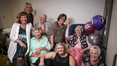 Living it up: Nessie Kluckhenn (waving) and her family enjoy her 110th birthday party.