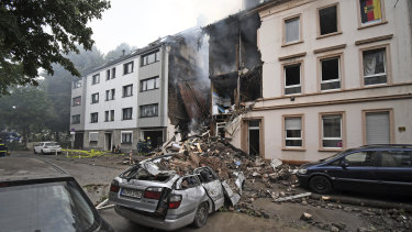 A car and a house are destroyed after an explosion in Wuppertal, Germany.
