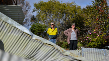 Lyn and Allan Wallwork are living in their shed while waiting for the removal of their destroyed Sarsfield home.