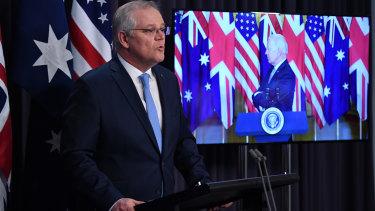 Prime Minister Scott Morrison appeared with US President Joe Biden and British Prime minister Boris Johnson at the rare joint virtual press conference.