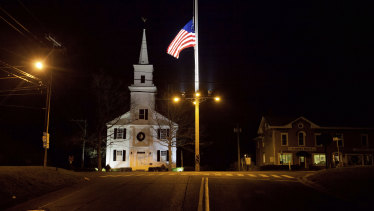 A US flag flies at half-mast on Main St in honour of the 26 students and staff killed in a mass shooting at the Sandy Hook Elementary school in Newtown, Connecticut in 2012.
