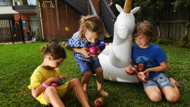 Ollie, Skye and Ash Coutts collect some of the 2 million Easter eggs made by Cadbury each day in the lead-up to Easter.
