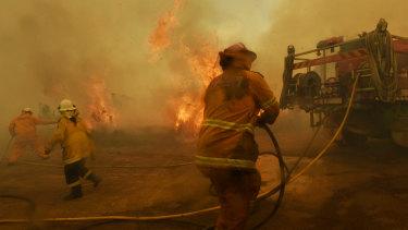 Spot fires threaten to overwhelm RFS volunteer firefighters at Hillville.