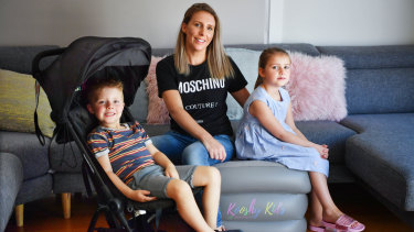 Louisa Williams with her children Mila and Jack and some of the baby equipment she shares through sharing platform Kindershare.