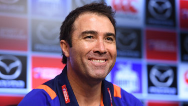 Winning grin: Coach Brad Scott after the Roos' fighting win over Hawks.